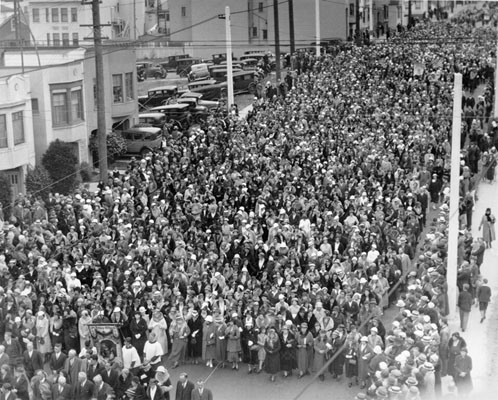 A crowd marches to St Anne's during novena (1933)